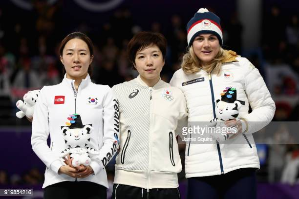 Silver medalist SangHwa Lee of Korea gold medalist Nao Kodaira of Japan and bronze medalist Karolina Erbanova of the Czech Republic celebrate during...