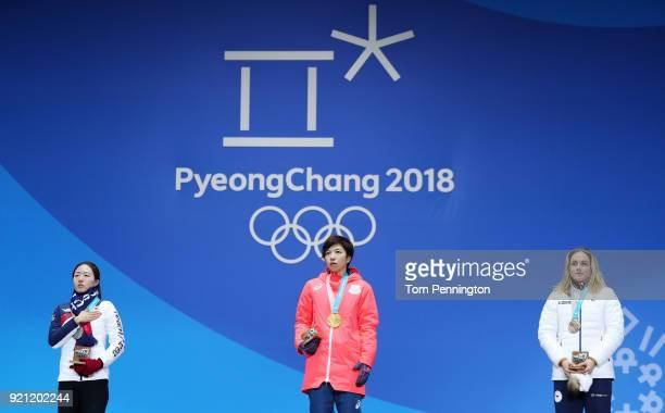 Silver medalist SangHwa Lee of Korea gold medalist Nao Kodaira of Japan and bronze medalist Karolina Erbanova of the Czech Republic stand on the...
