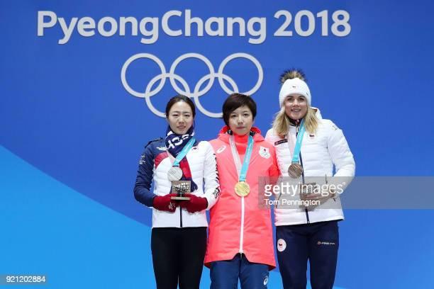 Silver medalist SangHwa Lee of Korea gold medalist Nao Kodaira of Japan and bronze medalist Karolina Erbanova of the Czech Republic celebrate during...