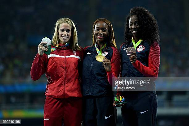 Silver medalist, Sara Slott Petersen of Denmark, gold medalist, Dalilah Muhammad of the United States, and bronze medalist Ashley Spencer of the...