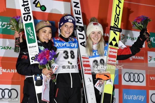 Silver medalist Sara Takanashi of Japan gold medalist Eva Pinkelnig of Austria and bronze medalist Chiara Hoelzl of Austria pose during the medal...
