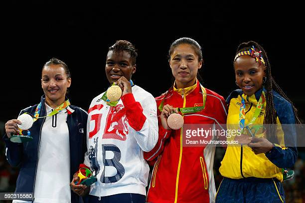 Silver medalist Sarah Ourahmoune of France, gold medalist Nicola Adams of Great Britain and bronze medalists Cancan Ren of China and Ingrit Valencia...