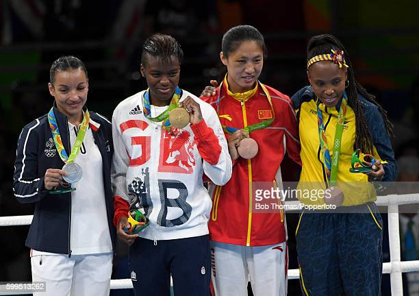 Silver medalist Sarah Ourahmoune of France gold medalist Nicola Adams of Great Britain and bronze medalists Cancan Ren of China and Ingrit Valencia...