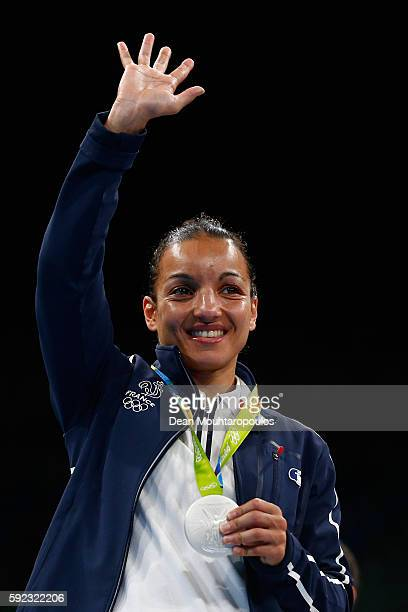 Silver medalist Sarah Ourahmoune of France poses during the medal ceremony for the Women's Fly on Day 15 of the Rio 2016 Olympic Games at Riocentro...