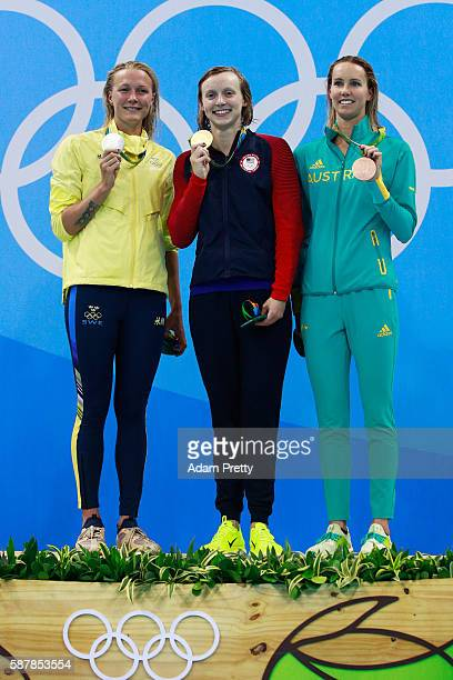 Silver medalist Sarah Sjostrom of Sweden gold medalist Katie Ledecky of the United States and brone medalist Emma McKeon of Australia pose on the...