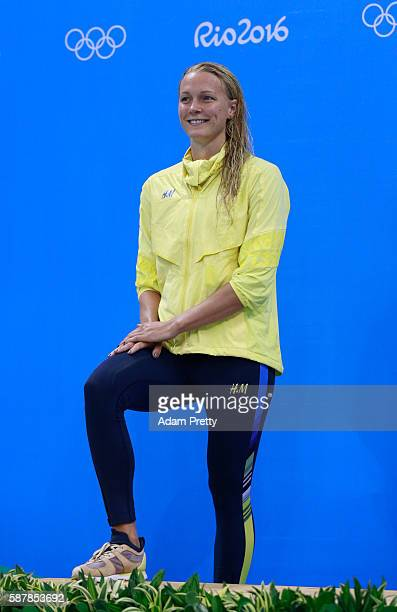 Silver medalist Sarah Sjostrom of Sweden poses on the podium during the medal ceremony for the Women's 200m Freestyle Final on Day 4 of the Rio 2016...
