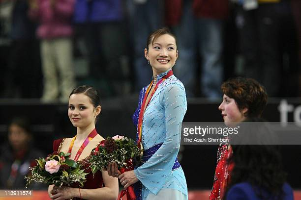 Silver medalist Sasha Cohen of the United States gold medalist Shizuka Arakawa of Japan and bronze medalist Irina Slutskaya of Russia pose on the...