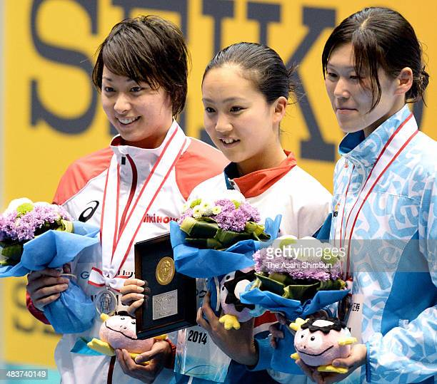 Silver medalist Satomi Suzuki gold medalist Kanako Watanabe and bronze medalist Rie Kaneto pose for photographs at the award ceremony for the Women's...