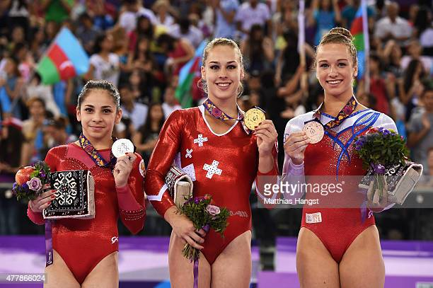 Silver medalist Seda Tutkhalyan of Russia gold medalist Giulia Steingruber of Switzerland and bronze of Lisa Top of the Netherlands stand on the...