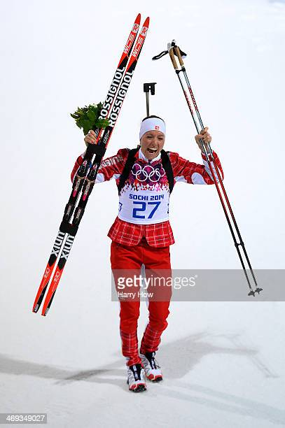 Silver medalist Selina Gasparin of Switzerland celebrates after the flower ceremony for the Women's 15 km Individual during day seven of the Sochi...