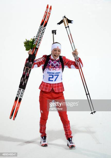 Silver medalist Selina Gasparin of Switzerland celebrates during the flower ceremony for the Women's 15 km Individual during day seven of the Sochi...