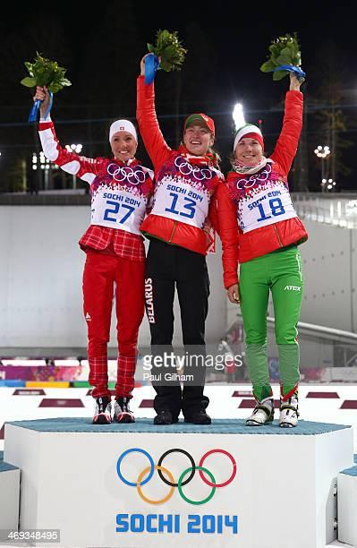 Silver medalist Selina Gasparin of Switzerland, gold medalist Darya Domracheva of Belarus and bronze medalist Nadezhda Skardino of Belarus celebrate...