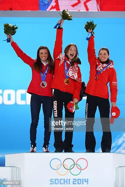 Silver medalist Selina Gasparin of Switzerland, gold medalist Darya Domracheva of Belarus and bronze medalist Nadezhda Skardino of Beralus on the...