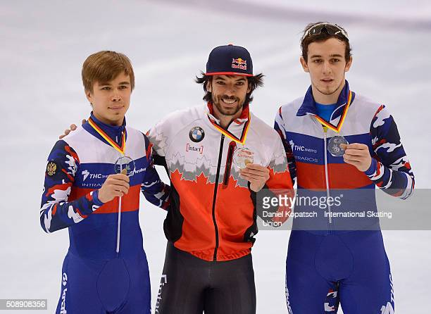 Silver medalist Semen Elistratov of Russia gold medalist Charles Hamelin of Canada and bronze medalist Dmitry Migunov of Russia pose after the Men...