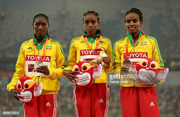 Silver medalist Senbere Teferi of Ethiopia gold medalist Almaz Ayana of Ethiopia and bronze medalist Genzebe Dibaba of Ethiopia pose on the podium...