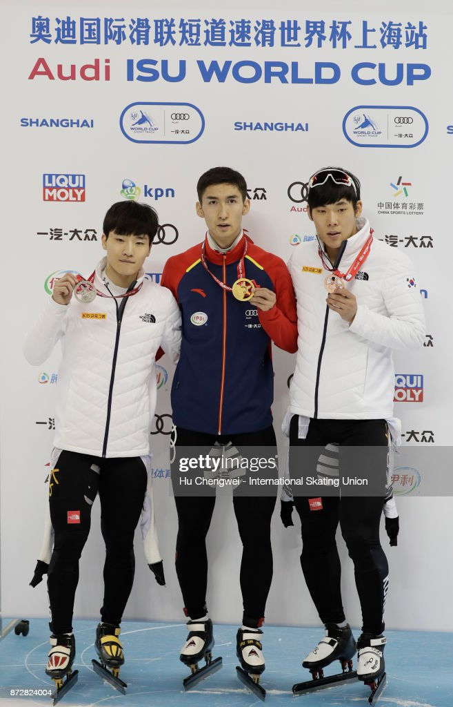 Silver medalist Seo Yi Ra of Korea, gold medalist Wu Dajing of China and bronze medalist Kim Do Kyoum of Korea pose during the men's 500m medal ceremony during the Audi ISU World Cup Short Track Speed Skating at on November 11, 2017 in Shanghai, China.