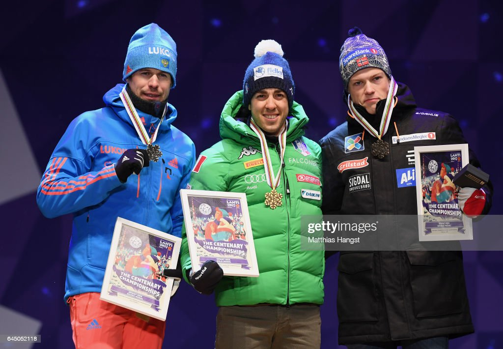 Silver medalist Sergey Ustiugov of Russia, gold medalist Federico Pellegrino of Italy and bronze medalist Johannes Hoesflot Klaebo of Norway pose with their medalds during the medal ceremony after the Men's 1.6 KM Cross Country Sprint final during the FIS Nordic World Ski Championships onon February 24, 2017 in Lahti, Finland.