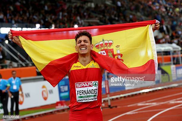 Silver medalist Sergio Fernandez carries the Spanish National Flag as he celebrates after the Men's 400m Hurdles Final at the European Athletics...