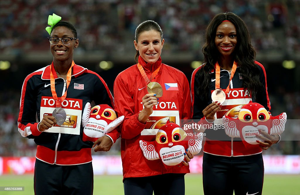 Silver medalist Shamier Little of the United States, gold medalist Zuzana Hejnova of the Czech Republic and bronze medalist Cassandra Tate of the United States pose on the podium during the medal ceremony for the Women's 400 metres hurdles final during day five of the 15th IAAF World Athletics Championships Beijing 2015 at Beijing National Stadium on August 26, 2015 in Beijing, China.