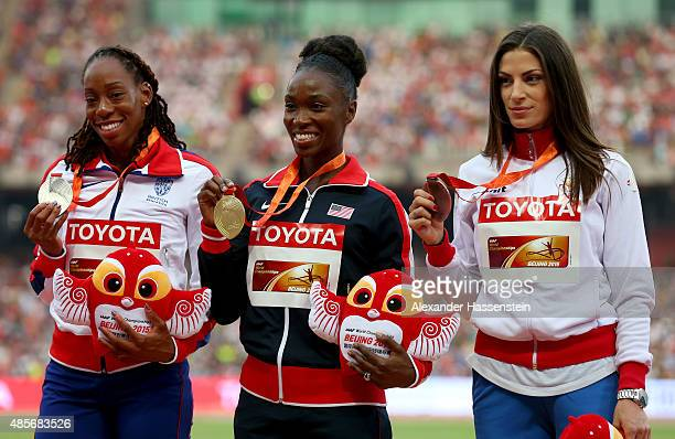 Silver medalist Shara Proctor of Great Britain gold medalist Tianna Bartoletta of the United States and bronze medalist Ivana Spanovic of Serbia pose...