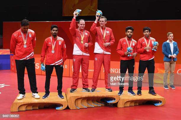 Silver medalist Sharath Achanta and Sathiyan Gnanasekaran of India gold medalist Paul Drinkhall and Liam Pitchford of England and bronze medalist and...
