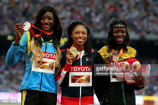 Silver medalist Shaunae Miller of the Bahamas, gold medalist Allyson Felix of the United States and bronze medalist Shericka Jackson of Jamaica pose...