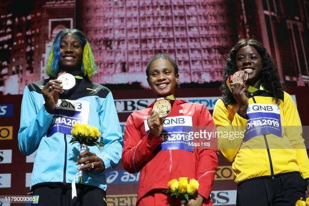 Silver medalist Shaunae Miller-Uibo of the Bahamas, gold medalist Salwa Eid Naser of Bahrain and bronze medalist Shericka Jackson of Jamaica stand on...