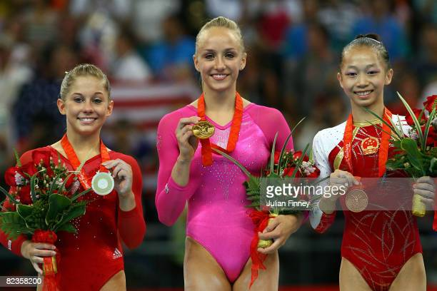 Silver medalist Shawn Johnson of the United States gold medalist Nastia Liukin of the United States and bronze medalist Yang Yillin of China pose...