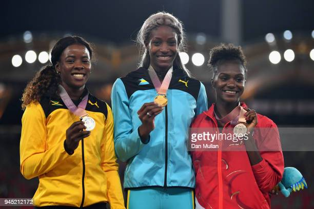 Silver medalist Shericka Jackson of Jamaica, gold medalist Shaunae Miller-Uibo of the Bahamas and bronze medalist Dina Asher-Smith of England pose...