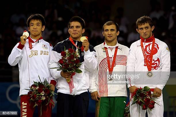 Silver medalist Shingo Matsumoto of Japan gold medalist Henry Cejudo of the United States bronze medalist Venelin Venkov of Bulgaria and bronze...