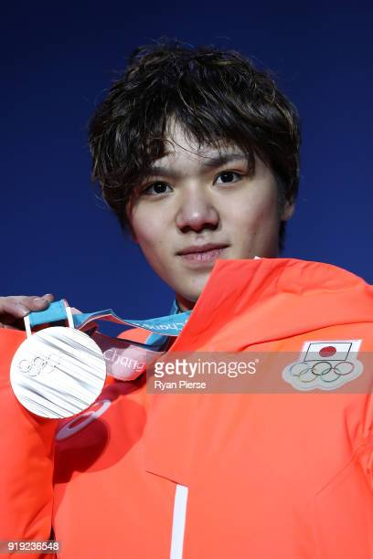 Silver medalist Shoma Uno of Japan celebrates during the medal ceremony for the Men's Figure Skating - Single Free Skating on day eight of the...