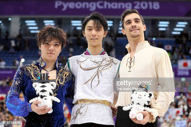 Silver medalist Shoma Uno of Japan gold medalist Yuzuru Hanyu of Japan and bronze medalist Javier Fernandez of Spain celebrate at the victory...