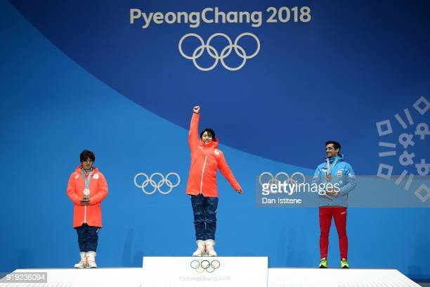 Silver medalist Shoma Uno of Japan, gold medalist Yuzuru Hanyu of Japan and bronze medalist Javier Fernandez of Spain celebrate during the medal...