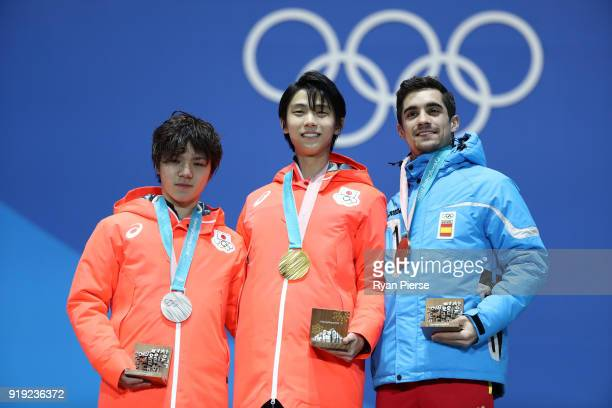 Silver medalist Shoma Uno of Japan gold medalist Yuzuru Hanyu of Japan and bronze medalist Javier Fernandez of Spain celebrate during the medal...