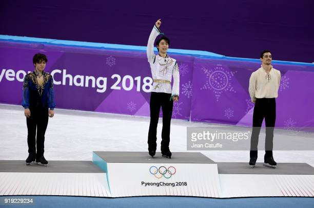 Silver medalist Shoma Uno of Japan gold medalist Yuzuru Hanyu of Japan bronze medalist Javier Fernandez of Spain during the victory ceremony...
