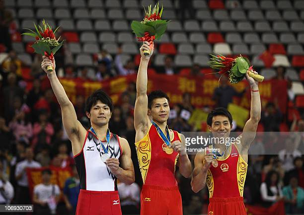 Silver medalist Shun Kuwahara of Japan gold medalist Chenglong Zhang of China and bronze medalist Haibin Teng of China after competiting in the Men's...
