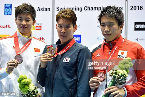 Silver medalist Shun Wang of China and Gold Medalist Park Taehwan of Sauth Korea and Bronze medalist Katsuhiro Matsumoto of Japan poses for...