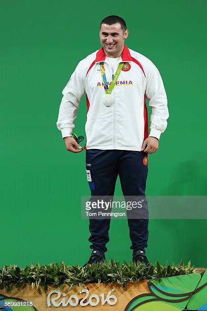Silver medalist Simon Martirosyan of Armenia celebrates on the podium during the medal ceremony during the Men's 105kg Group A Weightlifting contest...