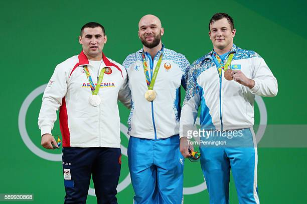 R] Silver medalist Simon Martirosyan of Armenia gold medalist Ruslan Nurudinov of Uzbekistan and bronze medalist Alexandr Zaichikov of Kazakhstan...