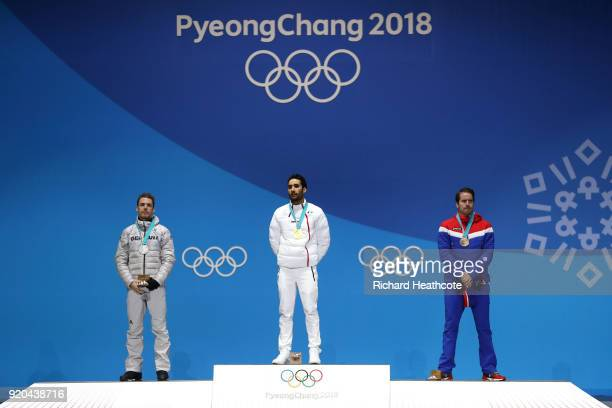 Silver medalist Simon Schempp of Germany, gold medalist Martin Fourcade of France and bronze medalist Emil Hegle Svendsen of Norway stand on the...