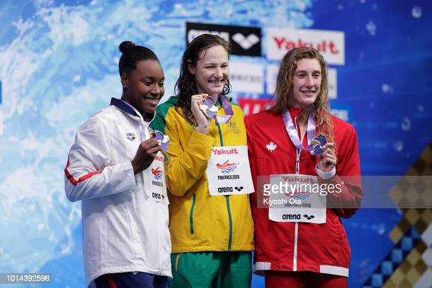 Silver medalist Simone Manuel of the United States gold medalist Cate Campbell of Australia and bronze medalist Taylor Ruck of Canada celebrate on...