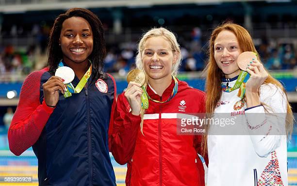 Silver medalist Simone Manuel of the United States Gold medalist Pernille Blume of Denmark and Bronze medalist Aliaksandra Herasimenia of Belarus...