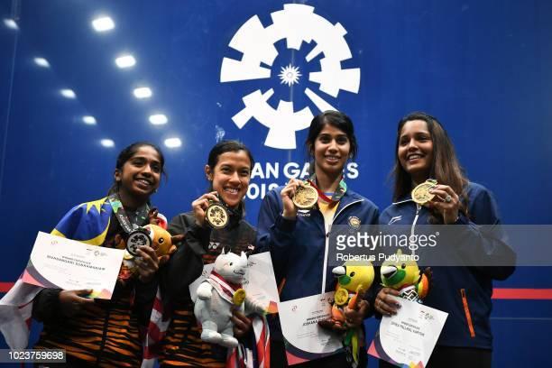 Silver medalist Sivasangari Subramaniam of Malaysia gold medalist Nicol Ann David of Malaysia and bronze medalist Joshana Chinappa and Dipika...