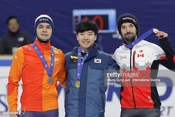 Silver medalist Sjinkie Knegt of Netherlands Gold medalist Seo YiRa of South Korea and Bronze medalist Charles Hamelin of Canada pose for medal...