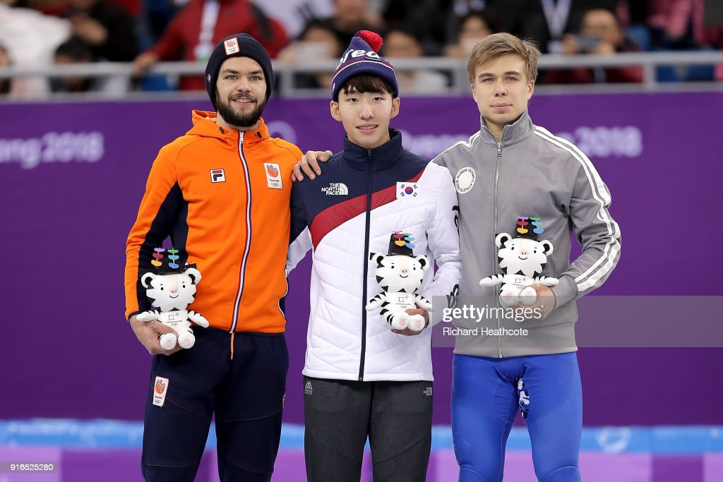 Silver medalist Sjinkie Knegt of the Netherlands, gold medalist Hyojun Lim of Korea and bronze medalist Semen Elistratov of Olympic Athlete from Russia celebrate at the victory ceremony after the Men's 1500m Short Track Speed Skating final on day one of the PyeongChang 2018 Winter Olympic Games at Gangneung Ice Arena on February 10, 2018 in Gangneung, South Korea.