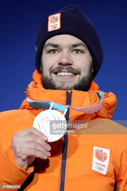 Silver medalist Sjinkie Knegt of the Netherlands poses on the podium during the Medal Ceremony for the Men's Short Track 1500m on day two of the...