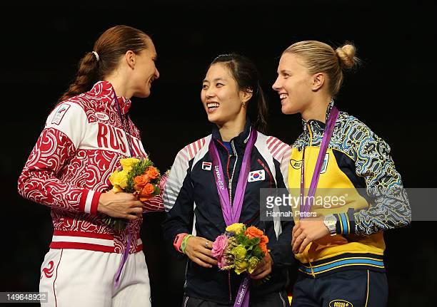 Silver medalist Sofya Velikaya of Russia gold medalist Jiyeon Kim of Korea and bronze medalist Olga Kharlan of Ukraine pose on the podium during the...