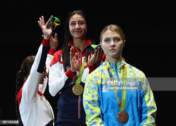 Silver medalist Sofya Velikaya of Russia gold medalist Yana Egorian of Russia and bronze medalist Olga Kharlan of Ukraine pose on the podium during...