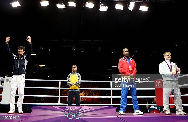 Silver medalist Soonchul Han of Korea gold medalist Vasyl Lomachenko of Ukraine bronze medalist Yasnier Toledo Lopez of Cuba and bronze medalist...