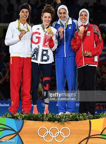 Silver medalist Spain's Eva Calvo Gomez, gold medalist Great Britain's Jade Jones, and bronze medalists Iran's Kimia Alizadeh Zenoorin and Egypt's...